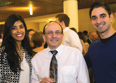 Isha Parulkar MD '15, left, and her twin brother, Anshul Parulkar '10 MD '18, right, with Associate Dean for Medical Education Allan Tunkel, MD , PhD (Credit: Scott Kingsley)