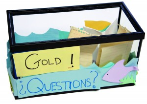 """Fish for Answers: As a TA, Léandre encouraged students to drop questions they were reluctant to ask in class into this aquarium. The """"Gold!"""" refers to the cutout goldfish, """"plus questions are gold!"""""""