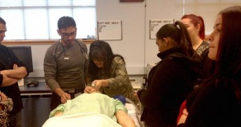 Sebastian Zuleta (top left) learns a clinical skill--intubation--during a Pipeline program class led by medical student Nery Porras.