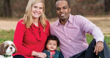 Elizabeth Davis, DVM '06, left; Stanley Voigt '06 MD'10, right; and their daughter, Clara Marie