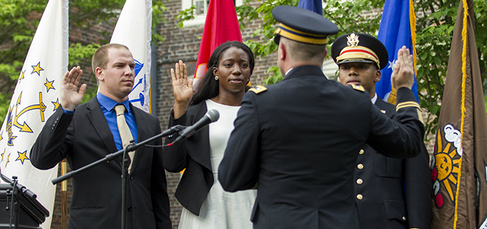 Army second lieutenants and Brown graduates Evan Stern, Uzoamaka Okoro, and Johnathan Davis, left to right, accept their ceremonial commissioning during Commencement weekend in May. Photo by Nicholas Dentamaro