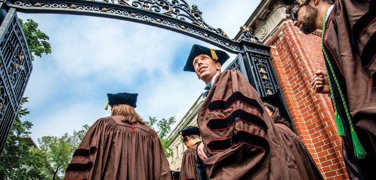 COMMENCEMENT: Will Mangham MD'16 walks through the Van Wickle Gates and into his future as a physician.