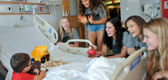 The Brown University volleyball team visits patients at Hasbro Children's Hospital on August 30, 2016. Brown's Student-Athlete Advisory Committee is teaming up with the Brown University Oncology Research Group to raise awareness and funds for cancer research. Photos courtesy of Hasbro Children's Hospital.