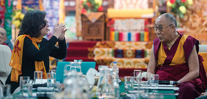 Cathy Kerr, left, presents her findings about perception and health to the Dalai Lama on December 15, 2015. Photo courtesy Tenzin Choejor/OHHDL