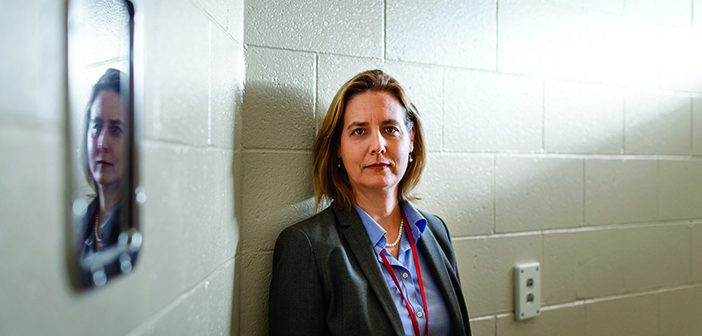 WONDER WOMAN: Jennifer Clarke in a temporary holding cell inside the dispensary at the Rhode Island Department of Corrections' John J. Moran Medium Security Facility in Cranston, RI. Clarke is RIDOC's medical programs director. Photo by Jared Leeds