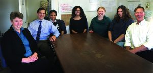 AVENGERS UNITE: The staff of the Center for Prisoner Health and Human Rights, from left to right: Michelle McKenzie, senior project director; Jody Rich, cofounder and director; Milly Perez-Cioe, executive secretary; Alex Macmadu, senior research assistant; Heather Gaydos, reentry project manager; Sarah Martino, project director; Bradley Brockmann, executive director. Photo by Patricia D'Aiello