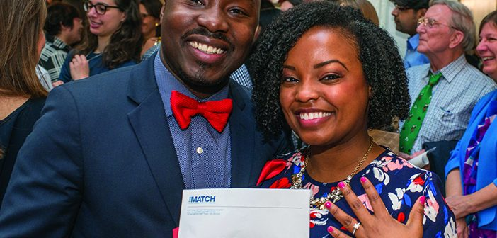 """ON BENDED KNEE: Moments after Courtney Johnson PHD'15 MD'17 learned she matched to her first-choice dermatology program, at John Hopkins, Rimsky Denis, MD, MBA, MPH, RES'17 proposed to her. """"I was truly floating on cloud nine!"""" she said later. They'll have one year together in Miami, where Johnson will do her prelim while Denis begins a three-year cardiology fellowship. Photo by David DelPoio"""