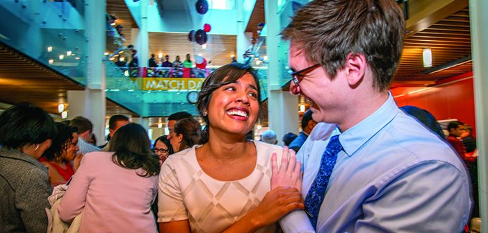 SWEET RELIEF: Meeka Gandhi MD'17, left, and Ryan Clodgelter MD'18. Meeka is headed west to the University of Washington. Photo by David DelPoio