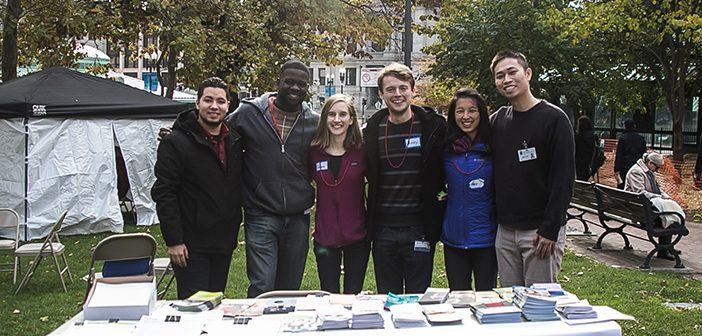 From left, Christian Delacruz, a former foster youth; Frank Paul, an MSW student at the Rhode Island College School of Social Work; and Warren Alpert medical students Gerianne Connell, James Maiarana, Alice Cao, and Austin Tam volunteered at the Fostering Hope table at a health fair in Providence last year. Photo courtesy Fostering Hope