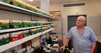 Gilad Barnea surveys shelves full of research flies in his lab. With trans-Tango he and his research team found new connections linking taste-sensing organs in the fly with specific regions in the brain. Photo by David Orenstein