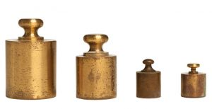 """Weighty Obsession: Creamer collects 19th-century scales and weights. """"I have so many of these pharmacy scales, I have no space for them,"""" he says. """"I have to clamp down."""""""