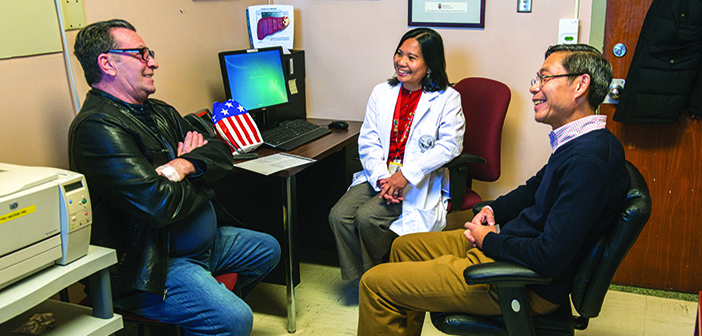 HOME FRONT: Veteran Nicholas Manzo, left, who has hepatitis C, meets with Marlene Callahan, PharmD, and Kittichai Promrat, MD , at the Providence VA Medical Center. Photo by David DelPoio