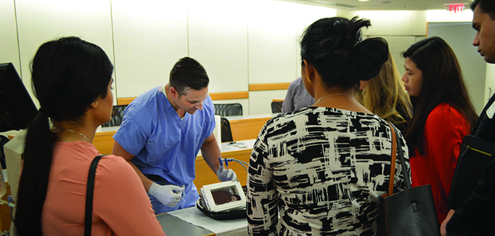 LOOK HERE: Jason Iannuccilli '00 MD'05 RES '10 demonstrates an ablation therapy at the regional IR symposium at Brown last year. Photo by Ishan Sinha '16 MD'20