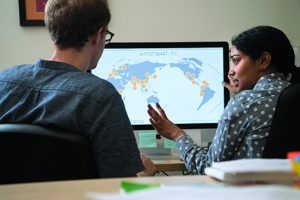 GLOBAL VIEW: Sam Smith PhD'23 (left) is a graduate student in Ramachandran's lab.