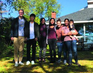ON RETREAT: Ramachandran Lab members in Maine (from left): Sam Smith, Wei Cheng, Sahar Shahamatdar, Priyanka Nakka, Lauren Alpert Sugden, Sohini Ramachandran, and Neerja Mumford (age 1).
