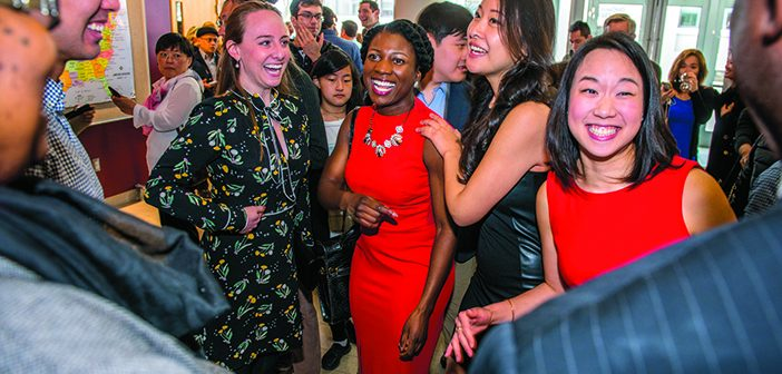 Cut ups: Meredith Adamo MD '18, Nicole Negbenebor MD '18, Alicia Lu MD '18, and Alice Tin MD '18 (left to right) share some laughs before the big reveal.