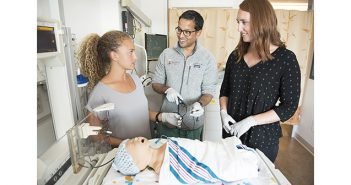 Ravi D'Cruz MD'13 RES'16 F'19 works with biomedical engineering students Kabisa Baughen '17 ScM'19 (left) and Shannon Crowley '17 to design a new device to help doctors perform blood draws and other procedures in the neonatal intensive care unit. Photo by Webb Chappell