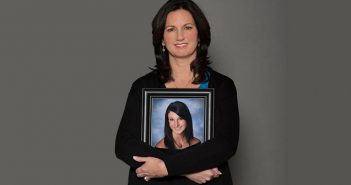 Patti Wukovits holds a photo of her daughter, Kim Coffey, who died in 2012 after contracting meningitis. Photo courtesy Kimberly Coffey Foundation