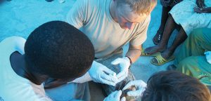 Mike Zaskey treats an infected wound in Haiti, in 2010. Photo courtesy Zaskey.