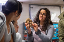 At Central Falls High School, Maya Ayoub MD'19 shows where the spinal cord connects to the brain. Photo by Nick Dentamaro