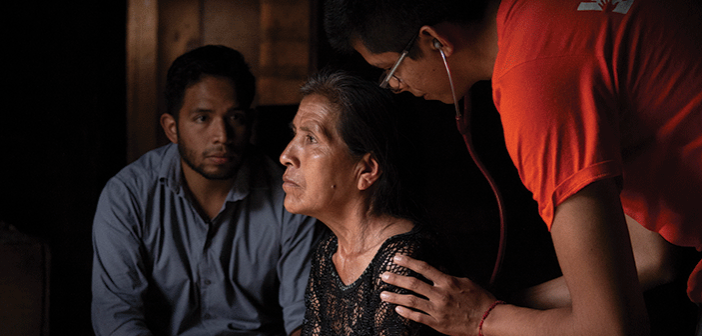 Argel Martínez, left, accompanies first-year physician José Luis Graciliano García, right, during a home visit with Eufemia Aranda Muñoz, a patient of Partners In Health being treated for tuberculosis in rural Chiapas. Photography: Mary Schaad/Partners In Health