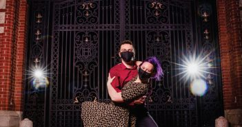 Liliana Luna-Nelson dances with partner Sam Oliphant infron of Brown's famed Van Wickle Gates.