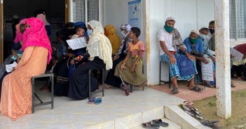 Rohingya refugees wait to get the COVID vaccine in Cox's Bazar, Bangladesh, in August. HAEFA operates two free clinics in refugee camps there.